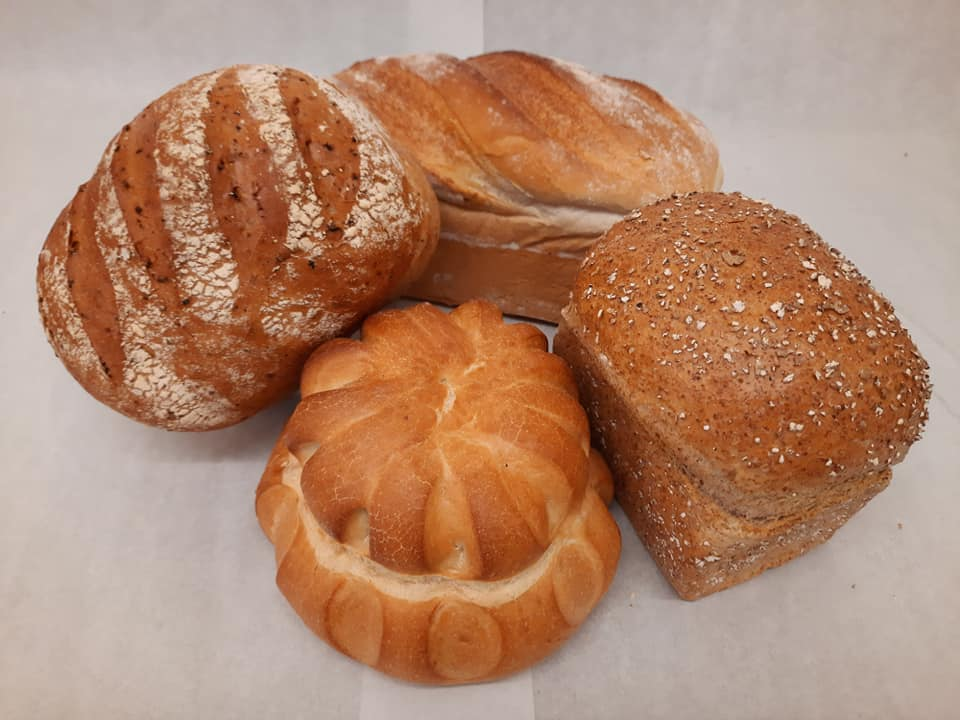 Photo of four artisan loaves of bread