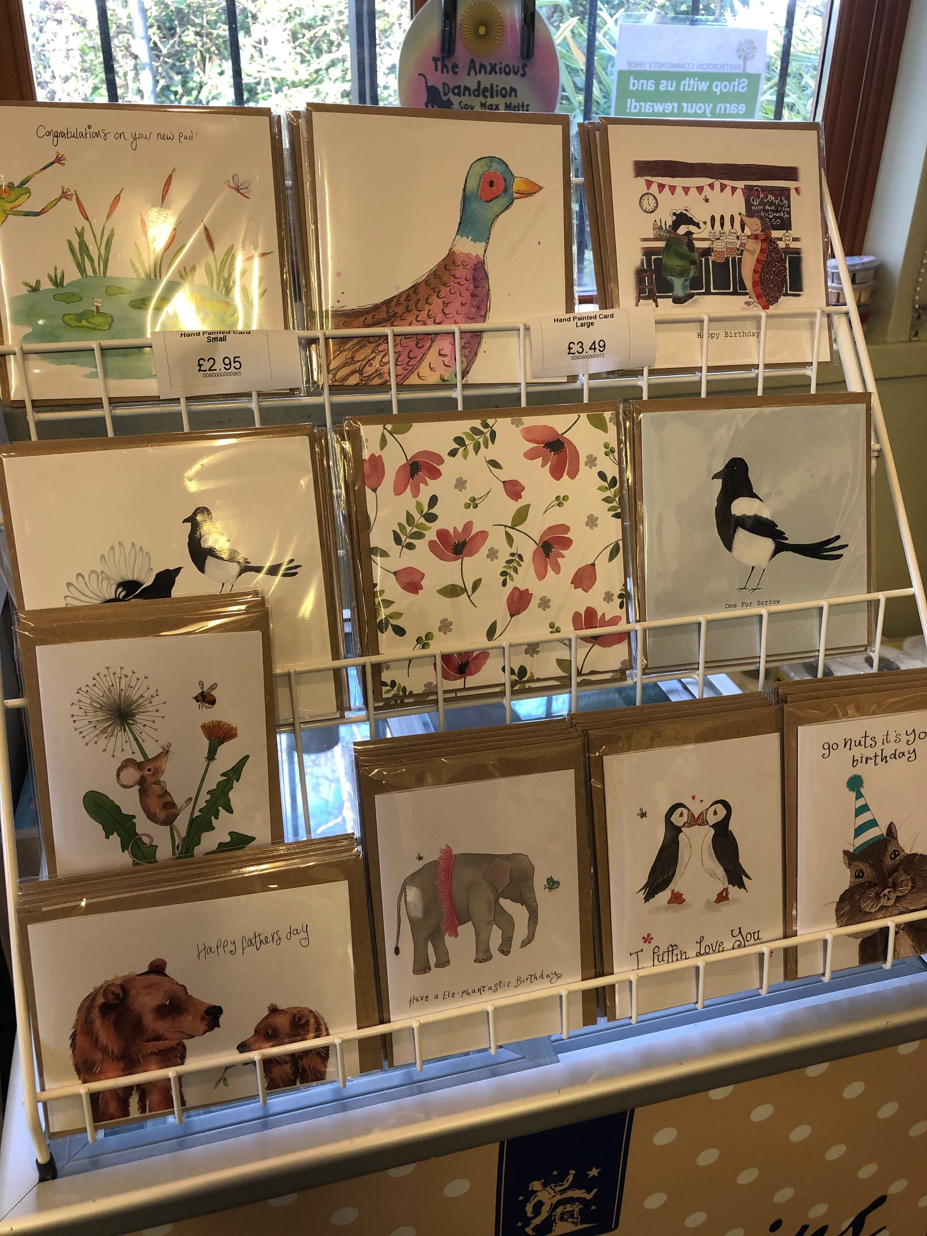 A photo of a rack of greetings cards