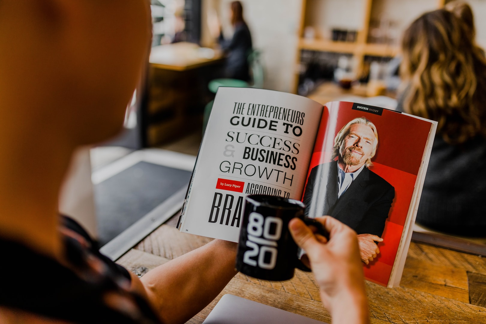 A photo of a book on business success with Richard Branson's photo